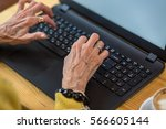 Old Woman's Hands And Laptop....