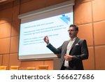 speaker giving talk on podium... | Shutterstock . vector #566627686