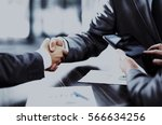 business people shaking hands | Shutterstock . vector #566634256