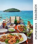 Small photo of Fresh seafood on the table in summer cafe on the Mediterranean coast. Location famous place Ksamil beach, Saranda popular coastal Albanian resort, Albania, Europa. Beauty world. Mobile photography.