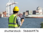 man inspect container in port | Shutterstock . vector #566664976