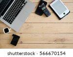 wooden desk with various... | Shutterstock . vector #566670154