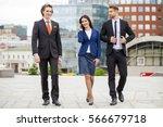 three business people walking... | Shutterstock . vector #566679718