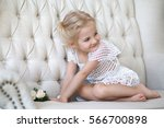 the little girl on a sofa | Shutterstock . vector #566700898