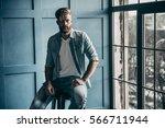 magic look. handsome young... | Shutterstock . vector #566711944