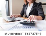 asian female accountant or... | Shutterstock . vector #566737549