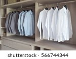 classic color shirts hanging in ... | Shutterstock . vector #566744344