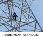 worker climbing on transmission ... | Shutterstock . vector #566749033