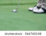 golf player put a golf ball on... | Shutterstock . vector #566760148