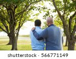 father parenting his son. | Shutterstock . vector #566771149