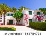 holiday villas and palm trees... | Shutterstock . vector #566784736