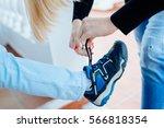 mother helping her son tie his... | Shutterstock . vector #566818354