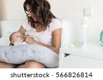 mother with newborn baby in the ... | Shutterstock . vector #566826814
