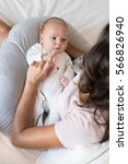mother with newborn baby in the ... | Shutterstock . vector #566826940