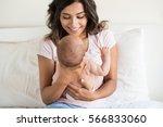Lovely Mother Holding Newborn...
