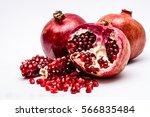 pomegranates on white background | Shutterstock . vector #566835484