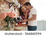 lovely couple in the kitchen | Shutterstock . vector #566860594