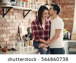 lovely couple in the kitchen | Shutterstock . vector #566860738