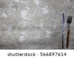 menu.stone table with fork and... | Shutterstock . vector #566897614