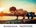 portrait of a fitness man doing ... | Shutterstock . vector #566903308