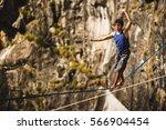 athlete walking in slackline  ... | Shutterstock . vector #566904454