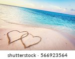 Two Hearts Drawn On Sand Of A...