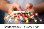 man holding smartphone with... | Shutterstock . vector #566927734