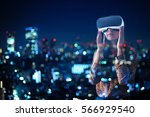 woman with glasses of virtual... | Shutterstock . vector #566929540