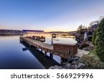 Private dock of waterfront home with jet ski lifts and covered boat lift, Lake Washington. Northwest, USA