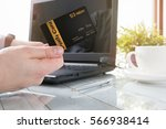 man is holding a loyalty card... | Shutterstock . vector #566938414