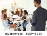 working group of freelancers... | Shutterstock . vector #566945380