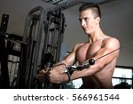 man doing cable fly exercise in ... | Shutterstock . vector #566961544