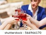 friends drinking wine on the... | Shutterstock . vector #566966170