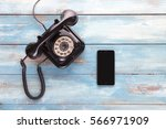 old telephone and mobile phone... | Shutterstock . vector #566971909