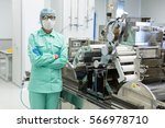 scientist in blue suit is... | Shutterstock . vector #566978710