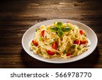pasta with meat and vegetables  | Shutterstock . vector #566978770