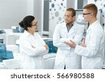 lab team. multiethnic group of... | Shutterstock . vector #566980588