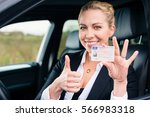 woman showing driving license... | Shutterstock . vector #566983318