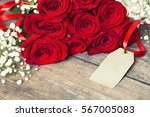 Stock photo red rose with gift paper for text on wooden background 567005083