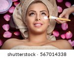 Small photo of Beauty women receiving treatment of facial mask