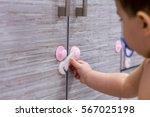 toddler child in kitchen ... | Shutterstock . vector #567025198