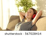 one teen listening music with... | Shutterstock . vector #567028414