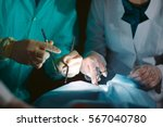 hands close up of surgeons... | Shutterstock . vector #567040780
