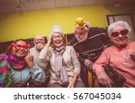 Group Of Seniors Taking Selfie...
