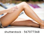 woman applying sun protection... | Shutterstock . vector #567077368