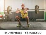 young muscular man doing squats ... | Shutterstock . vector #567086530