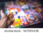 hand throws the dice on the... | Shutterstock . vector #567094198