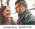 beautiful happy couple looking... | Shutterstock . vector #567097798