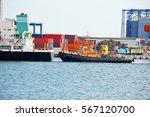 tugboat assisting bulk cargo... | Shutterstock . vector #567120700