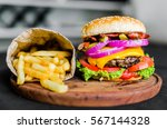 burger and french fries on a... | Shutterstock . vector #567144328